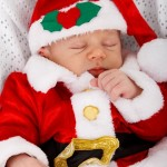 Sleeping baby in Christmas clothes