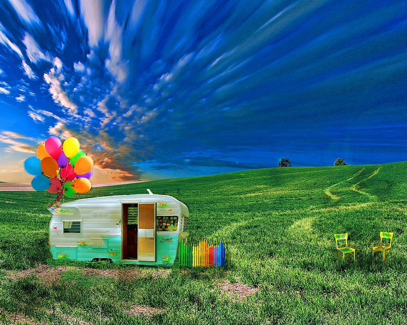 A caravan in a green field